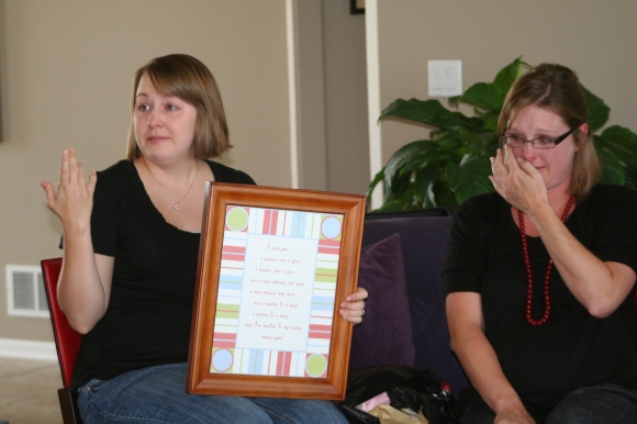 My friend, Melissa, helping me display the framed poem at my baby shower.