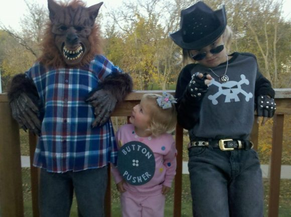 Halloween 2011 with the button pusher in the middle of her brothers