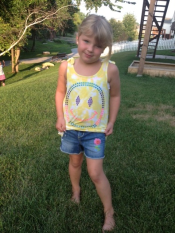 My daughter modeling her new favorite accessory, jean tattoos! (they easily wash off in normal wash cycle)